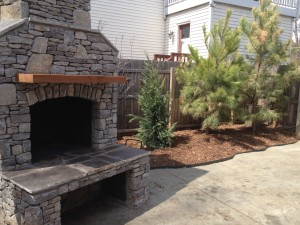 outdoor fireplace with mantle